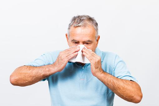 Senior man having flu