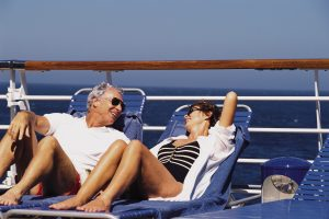 Mature couple on deck of cruise ship