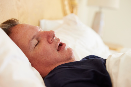 Overweight Man Asleep In Bed Snoring