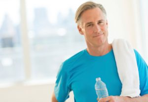 Confident Man With Towel And Water Bottle At Club