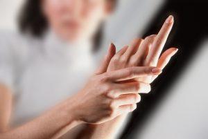 Woman Rubbing Her Hands