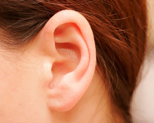 painless lump behind ear