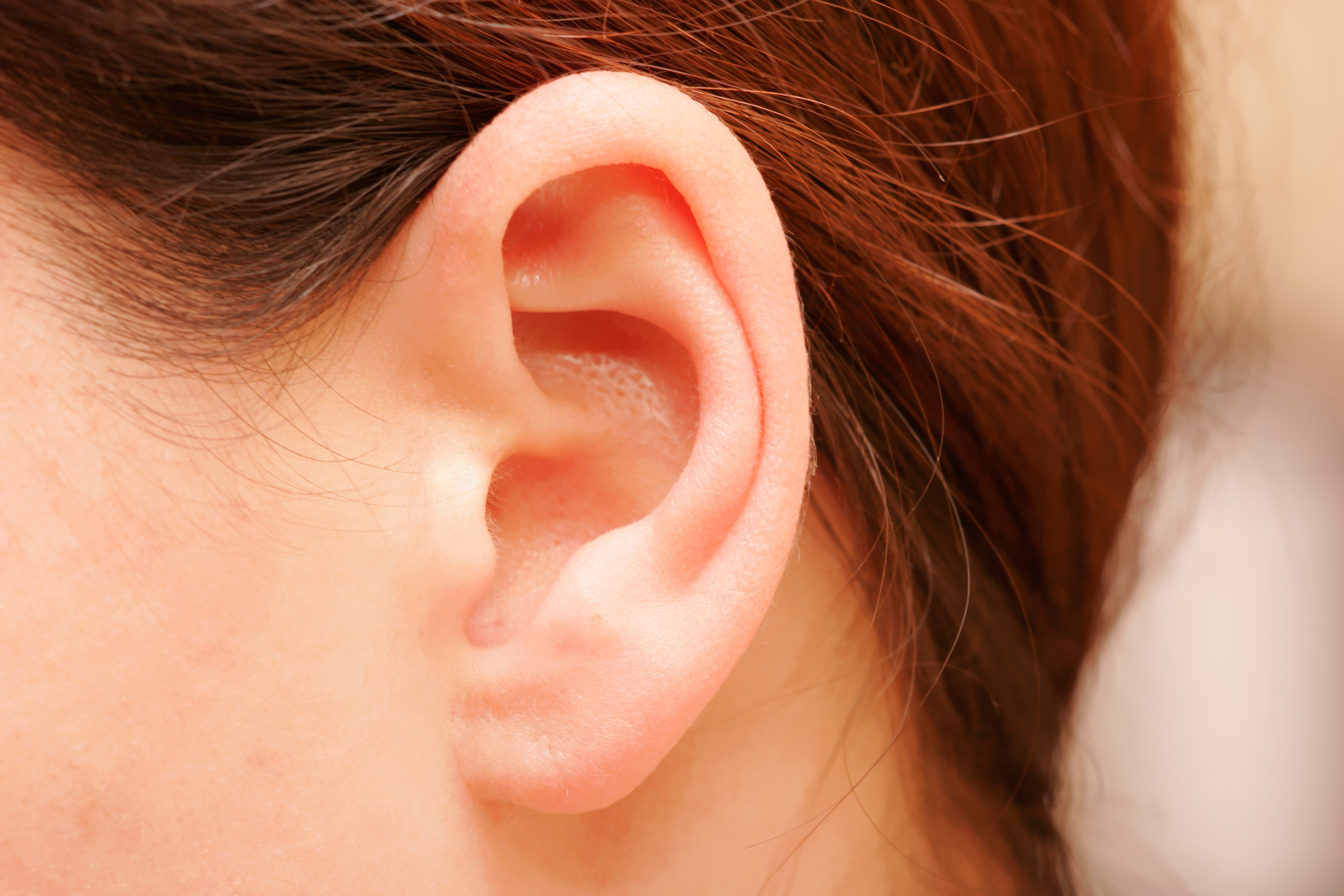 painless lump behind ear