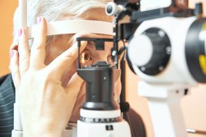 male patient under eye sight examination at ophthalmology clinic