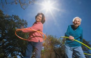 Low angle view of senior couple with hula hoops