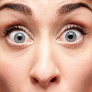 What causes bulging eyes or protruding eyeballs?