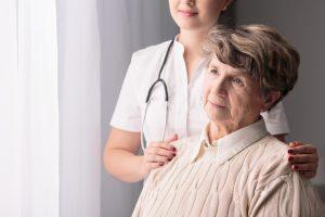 Picture of ill senior female and nurse