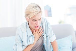 Pretty blonde woman having breath difficulties
