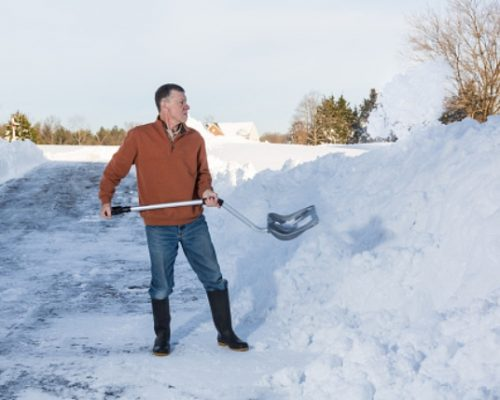 Tips to avoid back pain while snow shoveling