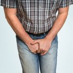 What causes testicular atrophy and how is it treated?