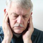 How does TMJ (temporomandibular joint) disorder cause tinnitus, hearing problems?