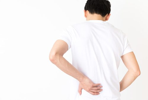 Man holding hip in pain