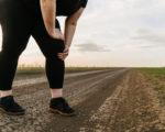 Knee ache. Overweight woman touching paining leg. Joints overload, sports trauma.