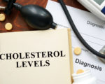 Cholesterol levels written on a book. Medical concept.