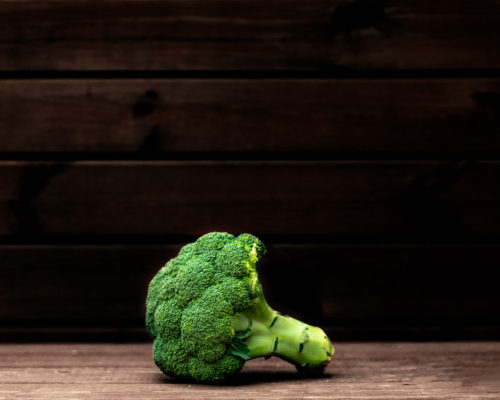 Broccoli vegetable on a dark background. Copy space. Fresh Broccoli closet up. Organic Food concept