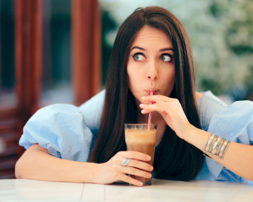 Cute girlfriend having a natural cold fruity beverage
