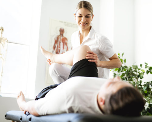 Modern rehabilitation physiotherapy woman worker with client