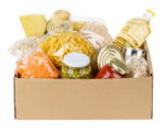 Various canned food, pasta and cereals in a cardboard box. Food donations or food delivery concept. Isolated on white.