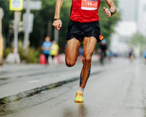 man runner leader of marathon race run street of city