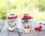 Natural yogurt with fresh raspberries, black currant and muesli. . Healthy dessert. Healthy food concept.