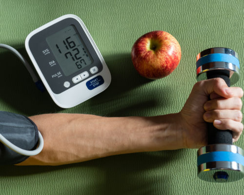 Healthy concept. Exercise and healthy eating are the causes of normal blood pressure.