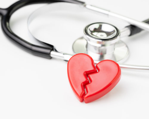 Heart attact or broken heart concept, cute read heart break with medical stethoscope on white background, health care, patient diagnostic and prevention.