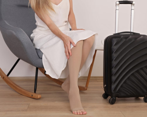 Varicose veins prevention, wearing Compression Stockings Thigh during flight