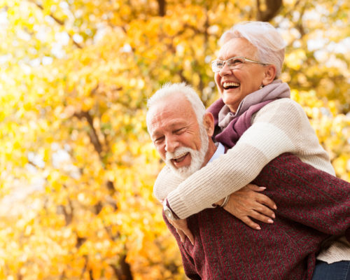 Portrait of healthy senior couple with toothy smile