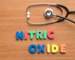Nitric oxide colorful word with stethoscope on the wooden background