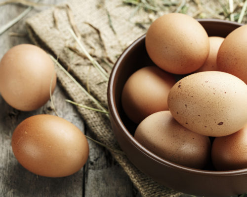 Brown eggs in a plate. Rural scene