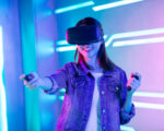 asian girl wear vr glasses and play gamesvertical of asian girl wear vr glasses and play gamesVertical of asian girl play car racing game with wearing vr glasses