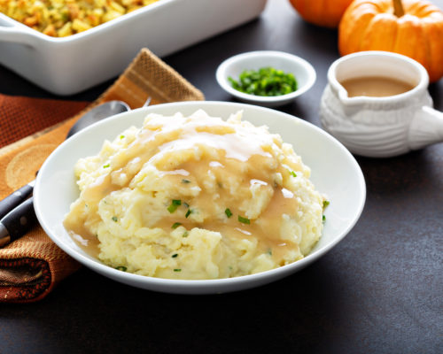 Mashed potatoes with gravy, traditional side dish for Thanksgiving