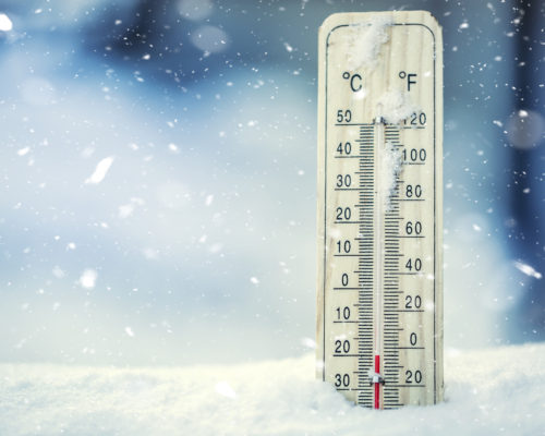 Thermometer on snow shows low temperatures under zero. Low temperatures in degrees Celsius and fahrenheit. Cold winter weather twenty under zero.Thermometer on snow shows low temperatures under zero. Low temperatures in degrees Celsius and fahrenheit. Cold winter weather twenty under zero.