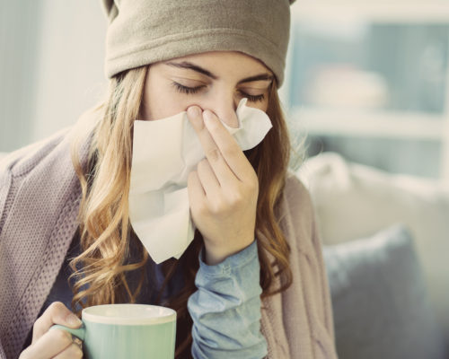 Young woman suffering from cold