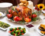 Delicious roasted turkey with savory vegetable side dishes in a fall theme.