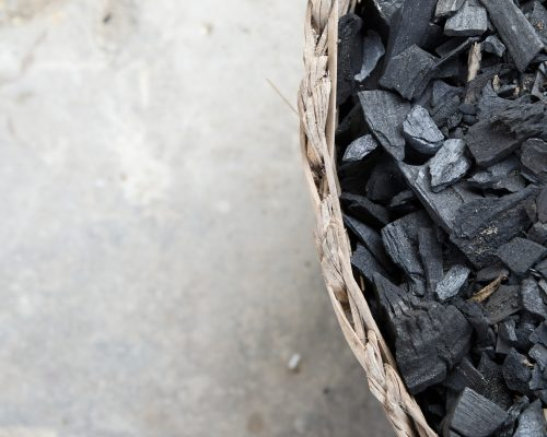 fraction of dust charcoal in the woven basket