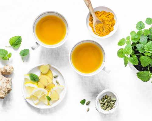 Turmeric, ginger anti-inflammatory green tea. Healthy detox drink on light background, top view