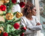 Pensive young black woman celebrating Christmas alone