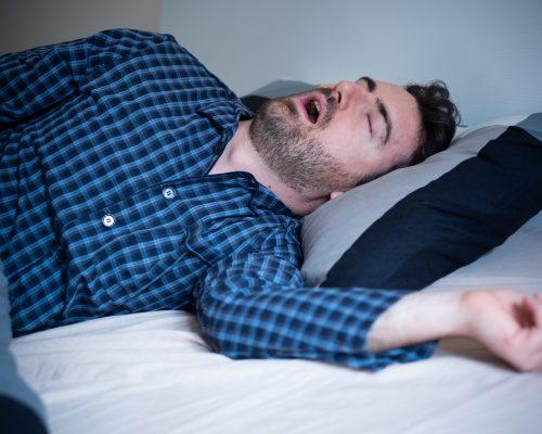Man snoring and suffering sahs at night