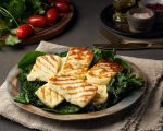 Cyprus fried halloumi cheese with healthy green salad. Lchf, pegan, fodmap, paleo, scd, keto, ketogenic diet. Balanced food, a greek clean eating recipe.