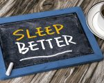 sleep better handwritten on blackboard