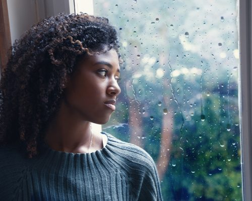 Black woman feeling depression symptoms alone at home