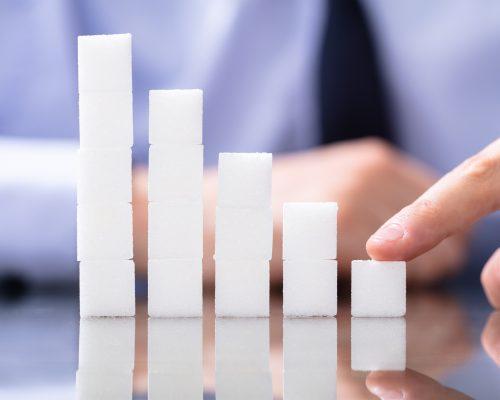 Reduce Sugar Concept. Sugar Cubes In Declining Chart