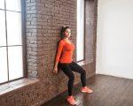 Balancing exercise. Activity woman looking at camera and doing workout. Studio shot