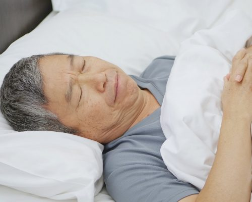 asian elder man tossed and turned all night
