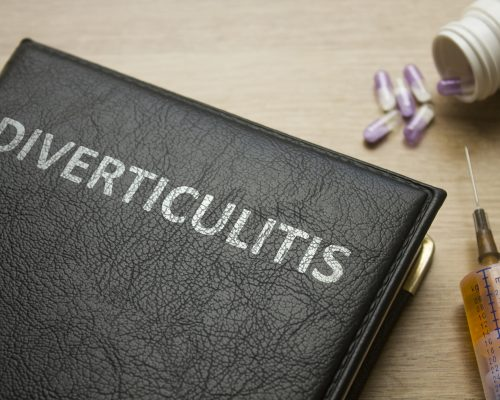 Book about Diverticulitis and medication, injection, syringe and pills