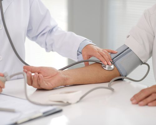 Doctor checking blood pressure of the patient