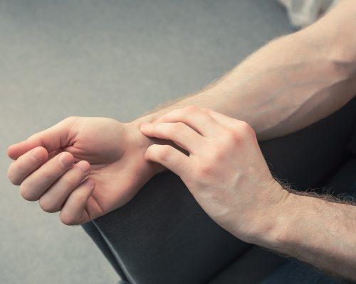 Man checks his pulse