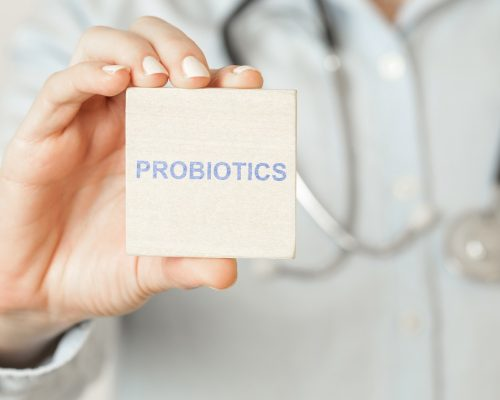 Doctor advises. Medical worker holds PROBIOTICS sign, healthy lifestyle concept.