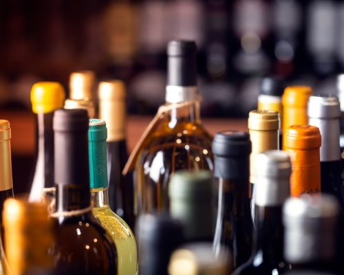Bottles of wine on the shelves of an alcohol shop in Spain, Alicante. Background, horizontal orientation